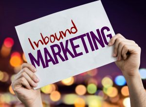 Sign saying inbound marketing with hands showing